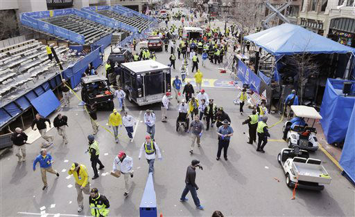 Police clear the area at the finish line of the 2013 Boston Marathon following an explosion in Boston, Monday, April 15, 2013.   Two explosions shattered the euphoria of the Boston Marathon finish line on Monday, sending authorities out on the course to carry off the injured while the stragglers were rerouted away from the smoking site of the blasts. &#40;AP Photo&#47;Charles Krupa&#41; <span class=meta>(AP Photo&#47; Charles Krupa)</span>