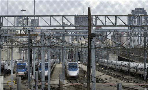 "<div class=""meta image-caption""><div class=""origin-logo origin-image ""><span></span></div><span class=""caption-text"">Amtrak trains sit idle in a train yard on the south side of Boston Friday, April 18, 2013 as all transit service remains shut down in the Boston area. Two suspects in the Boston Marathon bombing killed an MIT police officer, injured a transit officer in a firefight and threw explosive devices at police during their getaway attempt in a long night of violence that left one of them dead and another still at large Friday, authorities said as the manhunt intensified for a young man described as a dangerous terrorist.   (AP Photo/ Elise Amendola)</span></div>"