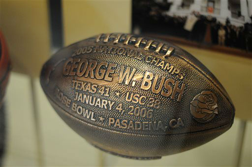 In this photo taken April 16, 2013, a football presented to president George W. Bush by the University of Texas Longhorns is seen in the museum area at the George W. Bush Presidential Library and Museum in Dallas.  The museum uses everything from news clips to interactive screens to artifacts to tell the story of Bush?s eight years in office. The George W. Bush Presidential Center, which includes the library and museum along with 43rd president?s policy institute, will be dedicated Thursday on the campus of Southern Methodist University in Dallas. &#40;AP Photo&#47;Benny Snyder&#41; <span class=meta>(AP Photo&#47; Benny Snyder)</span>