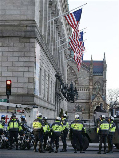 "<div class=""meta ""><span class=""caption-text "">Boston police officers keep a perimeter secure in Boston's Copley Square Tuesday, April 16, 2013 as an investigation continues into the bomb blasts at the finish area of the Boston Marathon which killed 3 and injured over 140 people Monday. (AP Photo/Elise Amendola) (AP Photo/ Elise Amendola)</span></div>"
