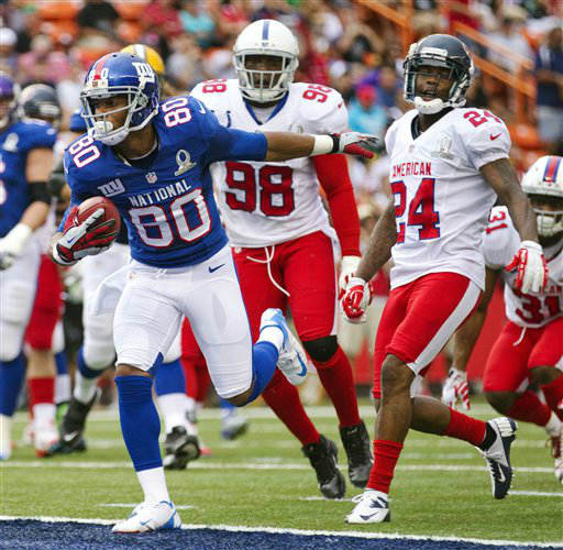 New York Giants wide receiver Victor Cruz &#40;80&#41; of the NFC breaks away from Indianapolis Colts outside linebacker Robert Mathis &#40;98&#41; and Houston Texans cornerback Johnathan Joseph &#40;24&#41; of the AFC to score a touchdown in the second quarter of the NFL football Pro Bowl game in Honolulu, Sunday, Jan. 27, 2013. &#40;AP Photo&#47;Eugene Tanner&#41; <span class=meta>(AP Photo&#47; Eugene Tanner)</span>