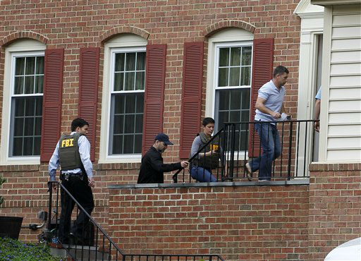 FBI agents escort Ruslan Tsarni, uncle of the Boston Marathon bombing suspects, second from right, into his home in Montgomery Village in Md. Friday, April, 19, 2013. The brothers, who came from a Russian region near Chechnya, lived together on Norfolk Street in Cambridge, Mass. They had been in the country for about a decade, according to an uncle, Ruslan Tsarni of Montgomery Village, Md.   <span class=meta>(AP Photo&#47; Jose Luis Magana)</span>