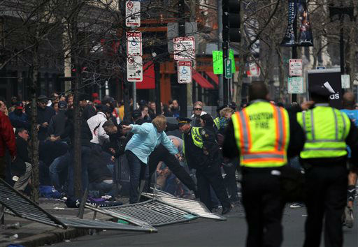 "<div class=""meta image-caption""><div class=""origin-logo origin-image ""><span></span></div><span class=""caption-text"">In this photo provided by The Daily Free Press and Kenshin Okubo, people react to an explosion at the 2013 Boston Marathon in Boston, Monday, April 15, 2013. Two explosions shattered the euphoria of the Boston Marathon finish line on Monday, sending authorities out on the course to carry off the injured while the stragglers were rerouted away from the smoking site of the blasts. (AP Photo/The Daily Free Press, Kenshin Okubo) MANDATORY CREDIT (AP Photo/ Kenshin Okubo)</span></div>"