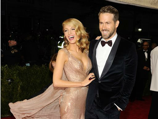 Blake Lively and Ryan Reynolds attend The Metropolitan Museum of Art&#39;s Costume Institute benefit gala celebrating &#34;Charles James: Beyond Fashion&#34; on Monday, May 5, 2014, in New York.  <span class=meta>(Photo&#47;Charles Sykes)</span>