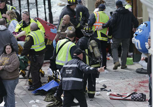 Medical workers aid injured people at the finish line of the 2013 Boston Marathon following an explosion in Boston, Monday, April 15, 2013. &#40;AP Photo&#47;Charles Krupa&#41; <span class=meta>(AP Photo&#47; Charles Krupa)</span>