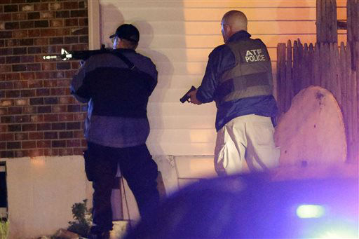 "<div class=""meta ""><span class=""caption-text "">Police officers aim their weapons Friday, April 19, 2013, in Watertown, Mass. A tense night of police activity that left a university officer dead on campus just days after the Boston Marathon bombings and amid a hunt for two suspects caused officers to converge on a neighborhood outside Boston, where residents heard gunfire and explosions.  (AP Photo/ Matt Rourke)</span></div>"