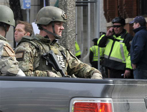 "<div class=""meta ""><span class=""caption-text "">Armed Massachusetts State Police roll into the area following an explosion at the 2013 Boston Marathon in Boston, Monday, April 15, 2013. Two explosions shattered the euphoria of the Boston Marathon finish line on Monday, sending authorities out on the course to carry off the injured while the stragglers were rerouted away from the smoking site of the blasts. (AP Photo/Josh Reynolds) (AP Photo/ Josh Reynolds)</span></div>"