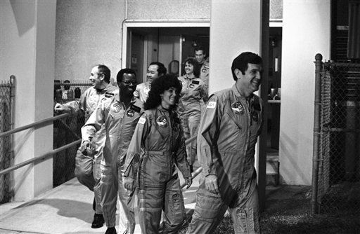 The crew for the Space Shuttle Challenger leaves the crew quarters at the Kennedy Space Center, Florida, Jan. 27, 1986, en route to the launch pad. Front to back are: Commander Francis Scobee, Mission Special Specialist Judy Resnick, Mission Special Specialist Ronald McNair, Payload Specialist Gregory Jarvis, Mission Specialist Ellison Onizuka, teacher Christa McAuliffe, and Pilot Michael Smith.  <span class=meta>(AP Photo&#47; Paul Kizzle)</span>