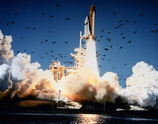 "<div class=""meta ""><span class=""caption-text "">In this Jan. 28, 1986 photo, the space shuttle Challenger lifts off Pad 39B at Kennedy Space Center, Florida.  A whole generation -- including McAuliffe's own students -- has grown up since McAuliffe and six other astronauts perished on live TV on Jan. 28, 1986. Now the former schoolchildren who loved her are making sure that people who weren't even born then know about McAuliffe and her dream of going into space. (AP Photo/ NASA)</span></div>"
