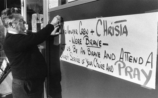 "<div class=""meta ""><span class=""caption-text "">Concord, New Hampshire, storeowner Barry Dixon tapes a sign to the outside of his business, Jan. 29, 1986 in tribute to the crew of the space shuttle Challenger, including Concord schoolteacher Christa McAuliffe, who were killed in the explosion of the shuttle. (AP Photo/ Toby Talbot)</span></div>"