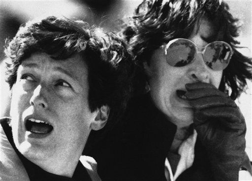 These two unidentified spectators reacted with horror as they witnessed space shuttle Challenger exploding minutes after liftoff on Tuesday, Jan. 30, 1986.  <span class=meta>(AP Photo)</span>