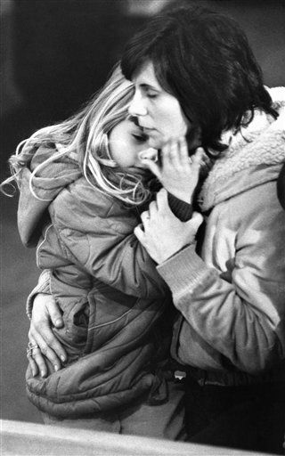 Arlene Dressler, right, holds her 4-year-old daughter Beth Ellen during a memorial service for teacher Christa McAuliffe at St. John&#39;s Church in Concord, New Hampshire, Wednesday, Jan. 30, 1986. McAuliffe was killed in the explosion of the space shuttle Challenger. <span class=meta>(AP Photo&#47; David Tenenbaum)</span>