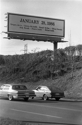 A billboard showing the date of the space shuttle Challenger disaster along with the names of the seven astronauts who lost their lives aboard the shuttle stands on a hill overlooking motorists passing by on Pulaski Highway in Baltimore, Maryland on Jan. 31, 1986. <span class=meta>(AP Photo&#47; Joe Giza)</span>