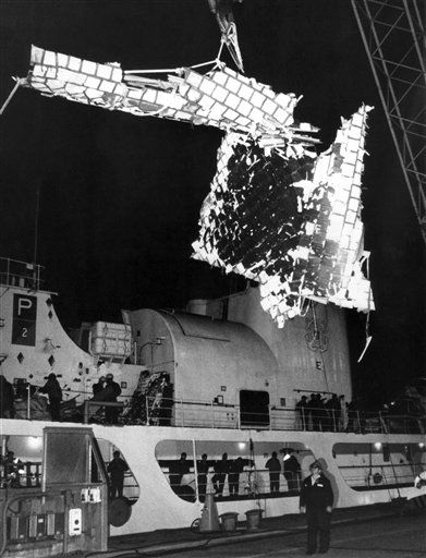 "<div class=""meta image-caption""><div class=""origin-logo origin-image ""><span></span></div><span class=""caption-text"">In this photo provided by NASA, part of the debris of the Space Shuttle Challenger is lowered to dockside at Port Canaveral, Florida, Feb. 1, 1986.   (AP Photo/ NASA)</span></div>"
