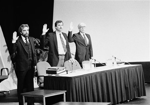 Being sworn in to testify before the Presidential Commission on the Space Shuttle Challenger Accident are, from left to right:  Bill Barsh, engineering manager of Lockheed Space Operations Co.; Robert Lang, Shuttle Operations, Mechanical Systems Division; and Carver Kennedy, VAB Operations manager, Morton Thiokol, Inc.  The Commission met in the Visitors Center at Kennedy Space Center in Florida, March 7, 1986.  <span class=meta>(AP Photo&#47; Phil Sandlin)</span>