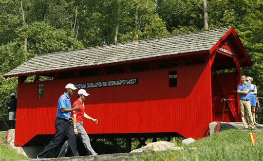 NO. 4: CARMEL, IN -- Tiger Woods, left, and Rory McIlroy, of Northern Ireland, walk past the covered bridge at the sixth hole during the first round of the BMW Championship PGA golf tournament at Crooked Stick Golf Club in Carmel, Indiana. <span class=meta>(AP Photo&#47; Charles Rex Arbogast)</span>