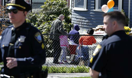 "<div class=""meta image-caption""><div class=""origin-logo origin-image ""><span></span></div><span class=""caption-text"">Neighbors come to pay their respects at the Richard house in the Dorchester neighborhood of Boston, Tuesday, April 16, 2013.  Martin Richard, 8, was killed in Monday's bombings at the finish line of the Boston Marathon. (AP Photo/Michael Dwyer) (AP Photo/ Michael Dwyer)</span></div>"