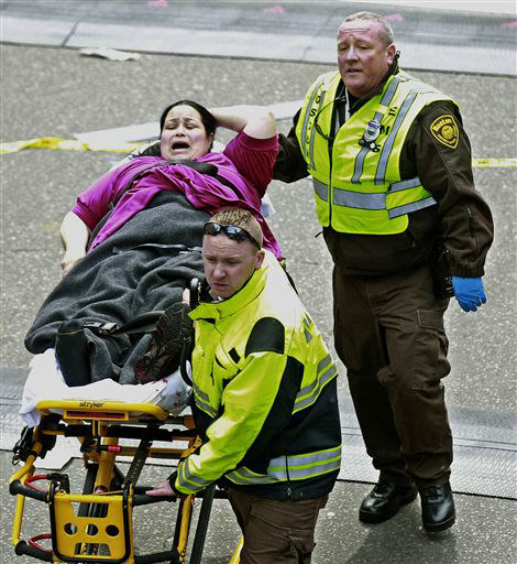 Medical workers aid an injured woman at the finish line of the 2013 Boston Marathon following two explosions there, Monday, April 15, 2013 in Boston. Two bombs exploded near the finish of the Boston Marathon on Monday, killing at least two people, injuring at least 23 others and sending authorities rushing to aid wounded spectators. &#40;AP Photo&#47;Charles Krupa&#41; <span class=meta>(AP Photo&#47; Charles Krupa)</span>