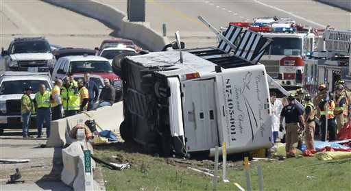 Emergency responders works the scene of  bush crash on the George Bush Turnpike Thursday, April 11, 2013, in Irving, Texas. The chartered bus overturned on the busy highway near Dallas killing at least two people and injuring several others, authorities said. &#40;AP Photo&#47;LM Otero&#41; <span class=meta>(AP Photo&#47; LM Otero)</span>