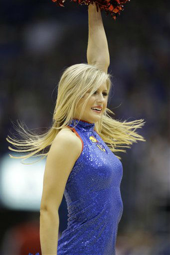 A Kansas cheerleader during the second half of an NCAA college basketball game against West Virginia in Lawrence, Kan., Saturday, March 2, 2013. Kansas defeated West Virginia 91-65. &#40;AP Photo&#47;Orlin Wagner&#41; <span class=meta>(AP Photo&#47; Orlin Wagner)</span>