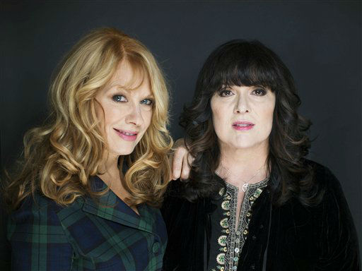 FILE - This Oct. 1, 2012 file photo shows sisters Ann, left, and Nancy Wilson from Heart in New York. The eclectic group of rockers Rush and Heart, rappers Public Enemy, songwriter Randy Newman, &#34;Queen of Disco&#34; Donna Summer and bluesman Albert King will be inducted into the Rock and Roll Hall of Fame next April in Los Angeles. The inductees were announced Tuesday by 2012 inductee Flea of The Red Hot Chili Peppers at a news conference in Los Angeles. &#40;Photo by Victoria Will&#47;Invision&#47;AP Images&#41; <span class=meta>(Photo&#47;Victoria Will)</span>