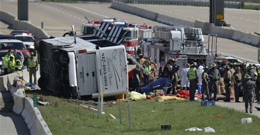 A fatality is rolled away as emergency responders works the scene of  bush crash on the George Bush Turnpike Thursday, April 11, 2013, in Irving, Texas. The chartered bus overturned on the busy highway near Dallas on killing at least two people and injuring several others, authorities said. &#40;AP Photo&#47;LM Otero&#41; <span class=meta>(AP Photo&#47; LM Otero)</span>