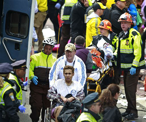 Medical workers aid injured people at the finish line of the 2013 Boston Marathon following an explosion Monday, April 15, 2013 in Boston. Two bombs exploded near the finish line of the marathon on Monday, killing at least two people, injuring at least 22 others and sending authorities rushing to aid wounded spectators. &#40;AP Photo&#47;Charles Krupa&#41; <span class=meta>(AP Photo&#47; Charles Krupa)</span>