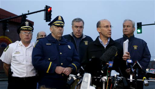 Officials address the media during a news conference in Watertown, Mass., Friday, April 19, 2013. Officials are urging residents of Watertown and surrounding towns to stay indoors. One of two suspects in the Boston Marathon bombing is dead after the killing of a university officer and a shootout with police, and a massive manhunt is underway for the other, authorities said early Friday.   <span class=meta>(AP Photo&#47; Julio Cortez)</span>