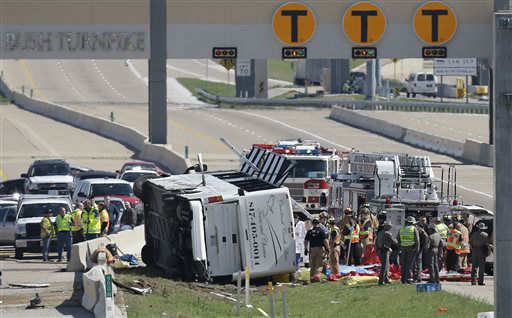 Emergency responders works the scene of  bush crash on the George Bush Turnpike Thursday, April 11, 2013, in Irving, Texas. The chartered bus overturned on the busy highway near Dallas on killing at least two people and injuring several others, authorities said. &#40;AP Photo&#47;LM Otero&#41; <span class=meta>(AP Photo&#47; LM Otero)</span>