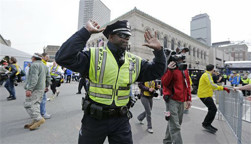 "<div class=""meta ""><span class=""caption-text "">A Boston police officer clears Boylston Street following an explosion at the finish line of the 2013 Boston Marathon in Boston, Monday, April 15, 2013. Two explosions shattered the euphoria at the finish line on Monday, sending authorities out on the course to carry off the injured while the stragglers were rerouted away from the smoking site of the blasts. (AP Photo/Charles Krupa) (AP Photo/ Charles Krupa)</span></div>"