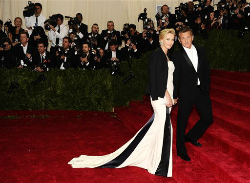 "<div class=""meta image-caption""><div class=""origin-logo origin-image ""><span></span></div><span class=""caption-text"">Charlize Theron and Sean Penn attendsThe Metropolitan Museum of Art's Costume Institute benefit gala celebrating ""Charles James: Beyond Fashion"" on Monday, May 5, 2014, in New York. (Photo/Charles Sykes)</span></div>"
