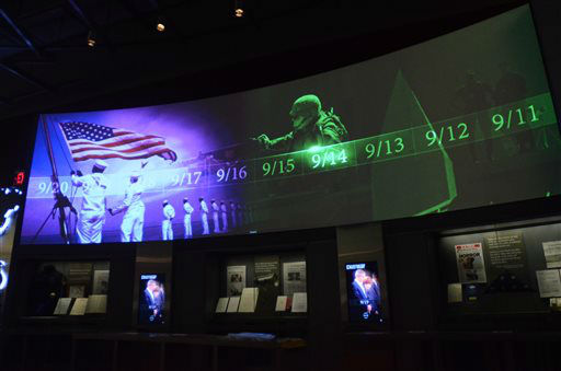 In this photo taken April 16, 2013, a large screen displays images and video of the events and days that followed the 9&#47;11 terrorist attacks as part of an exhibit in the museum area at the George W. Bush Presidential Library and Museum in Dallas.  The museum uses everything from news clips to interactive screens to artifacts to tell the story of Bush?s eight years in office. The George W. Bush Presidential Center, which includes the library and museum along with 43rd president?s policy institute, will be dedicated Thursday on the campus of Southern Methodist University in Dallas. &#40;AP Photo&#47;Benny Snyder&#41; <span class=meta>(AP Photo&#47; Benny Snyder)</span>