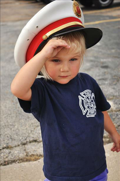 "<div class=""meta ""><span class=""caption-text "">A child salutes as the bodies of fallen firefighters arrive in a procession at a Houston funeral home. Photo submitted by an ABC13 viewer through our iWitness Reports. (Photo/cbrehm)</span></div>"
