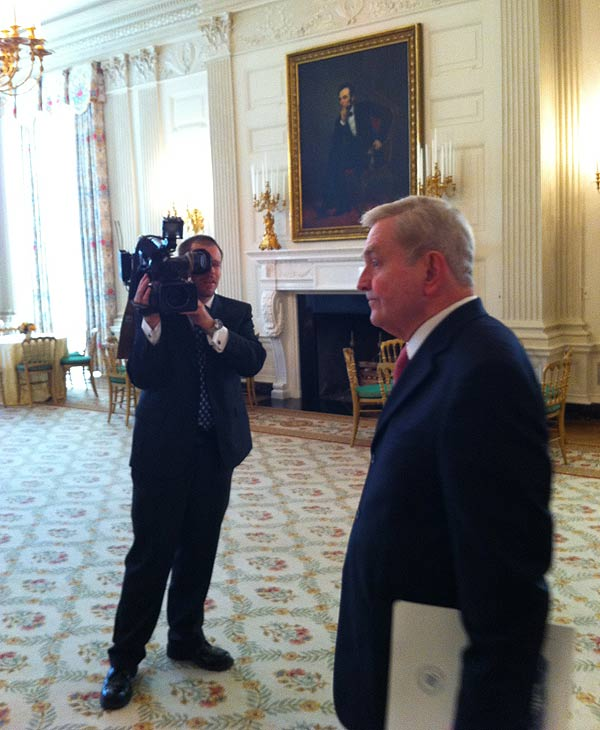 "<div class=""meta image-caption""><div class=""origin-logo origin-image ""><span></span></div><span class=""caption-text"">I'm in the state dining room of the White House. That's my photographer Charles Fisher. The people's house is magnificent!</span></div>"