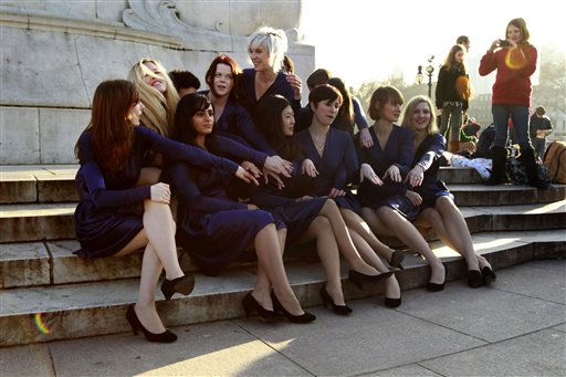 A group of students from the Royal College of Art pose for photographs wearing Kate Middleton style engagement outfits they made themselves and engagement rings outside Buckingham Palace in London, Wednesday, Jan. 19, 2011.  The group carried out the stunt for fun ahead of the wedding of Britain&#39;s Prince William and Kate Middleton in 100 days time on April 29, 2011.  &#40;AP Photo&#47;Matt Dunham&#41; <span class=meta>(AP Photo&#47; Matt Dunham)</span>