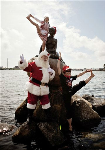 A Santa poses during the World Santa Claus Congress next to the Little Mermaid statue in the harbour of Copenhagen, on Monday, July 18, 2011. The World Santa Claus Congress has taken place in the Dyrehavsbakken amusement park &#40;usually shortened to Bakken&#41; north of Copenhagen since 1957. &#40;AP Photo&#47;POLFOTO, Joachim Adrian&#41;  DENMARK OUT <span class=meta>(AP Photo&#47; ADRIAN JOACHIM)</span>