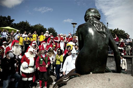 Participants pose for a photo  during the World Santa Claus Congress in front of  The Little Mermaid  statue in the harbour of Copenhagen, on Monday, July 18, 2011. The World Santa Claus Congress has taken place in the Dyrehavsbakken amusement park &#40;usually shortened to Bakken&#41; north of Copenhagen since 1957. &#40;AP Photo&#47;POLFOTO, Joachim Adrian&#41;  DENMARK OUT <span class=meta>(AP Photo&#47; ADRIAN JOACHIM)</span>