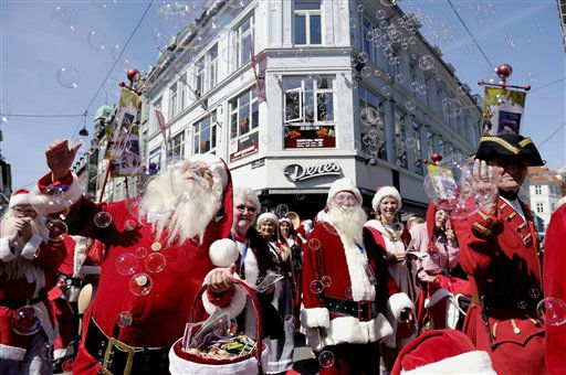 Men dressed as Santa Klaus  take part in a street parade in the famous pedestrian street Stroeget, during the World Santa Claus Congress, in central Copenhagen on Tuesday, July 19, 2011. The World Santa Claus Congress has taken place in the Dyrehavsbakken amusement park &#40;usually shortened as Bakken&#41; north of Copenhagen in Denmark since 1957. Every summer Bakken is invaded by Santas from around the world who gather to spread good Christmas cheer. &#40;AP Photo&#47;Polfoto, Kristian Linnemann&#41;  DENMARK OUT <span class=meta>(AP Photo&#47; LINNEMANN KRISTIAN)</span>