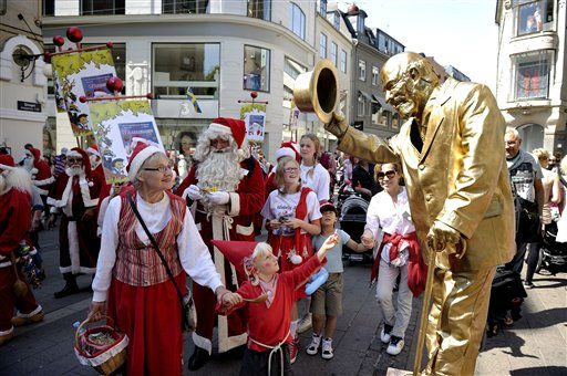 People dressed as Santa Klaus  take part in a street parade in the famous pedestrian street Stroeget, during the World Santa Claus Congress, in central Copenhagen on Tuesday, July 19, 2011. The World Santa Claus Congress has taken place in the Dyrehavsbakken amusement park &#40;usually shortened as Bakken&#41; north of Copenhagen in Denmark since 1957. Every summer Bakken is invaded by Santas from around the world who gather to spread good Christmas cheer. &#40;AP Photo&#47;Polfoto, Kristian Linnemann&#41;  DENMARK OUT <span class=meta>(AP Photo&#47; LINNEMANN KRISTIAN)</span>