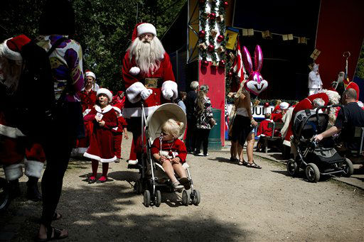 The World Santa Claus Congress, held at Bakken in Klampenborg, north of Copenhagen on Monday July 23, 2012. The World Santa Claus Congress ends Thursday. &#40;AP Photo&#47;POLFOTO, Finn Frandsen&#41;  DENMARK OUT <span class=meta>(AP Photo&#47; FRANDSEN FINN)</span>