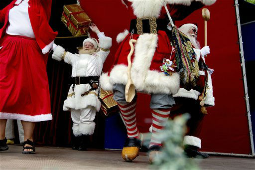 The World Santa Claus Congress, held at Bakken in Klampenborg, Copenhagen, on Monday July 23, 2012.  The World Santa Claus Congress ends Thursday. &#40;AP Photo&#47;POLFOTO, Finn Frandsen&#41;  DENMARK OUT <span class=meta>(AP Photo&#47; FRANDSEN FINN)</span>