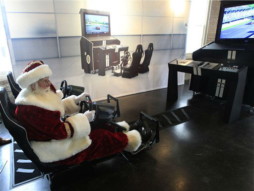 "<div class=""meta ""><span class=""caption-text "">Santa Clause, portrayed by Brady White, plays on the custom made Pinel & Pinel Arcade PS Trunk system during the unveiling of the Neiman Marcus 2012 Christmas Book in Dallas, Tuesday, Oct. 9, 2012. The fantasy gift arcade is priced for sale at $90,000.  (AP Photo/LM Otero) (AP Photo/ LM Otero)</span></div>"