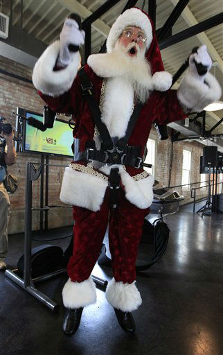Donning a jetpack, Brady White portrays Santa Clause as he demonstrates gifts during the unveiling of the Neiman Marcus 2012 Christmas Book in Dallas, Tuesday, Oct. 9, 2012.  The Jetlev R200 is priced at &#36;99,500. &#40;AP Photo&#47;LM Otero&#41; <span class=meta>(AP Photo&#47; LM Otero)</span>