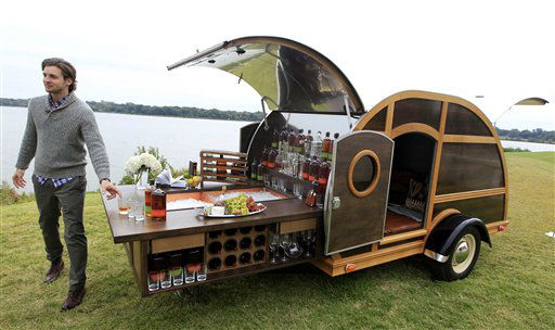 "<div class=""meta ""><span class=""caption-text "">A model displays the Bulleit Frontier Whisky Woody-Tailgate Trailer during the unveiling of the Neiman Marcus 2012 Christmas Book in Dallas, Tuesday, Oct. 9, 2012.  The trailer is priced for sale at $150,000.  (AP Photo/LM Otero) (AP Photo/ LM Otero)</span></div>"