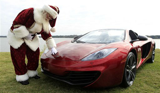Brady White portrays Santa Clause as he shows off a 2013 McLaren 12C spider sports car during the unveiling of the Neiman Marcus 2012 Christmas Book in Dallas, Tuesday, Oct. 9, 2012.  The Neiman Marcus edition is one of 12 made and priced at &#36;354,000. &#40;AP Photo&#47;LM Otero&#41; <span class=meta>(AP Photo&#47; LM Otero)</span>