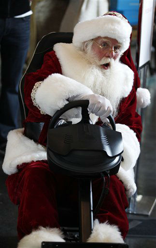 Santa Clause, portrayed by Brady White, plays on the custom made Pinel &amp; Pinel Arcade PS Trunk system during the unveiling of the Neiman Marcus 2012 Christmas Book in Dallas, Tuesday, Oct. 9, 2012. The fantasy gift arcade is priced for sale at &#36;90,000.  &#40;AP Photo&#47;LM Otero&#41; <span class=meta>(AP Photo&#47; LM Otero)</span>