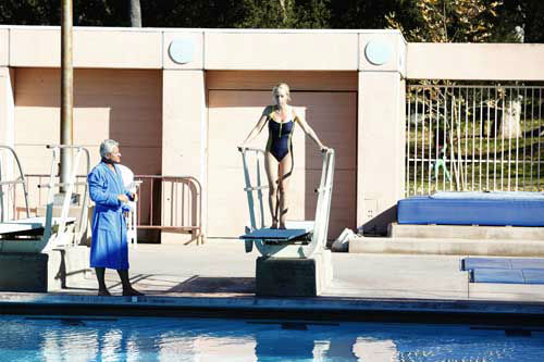 "<div class=""meta image-caption""><div class=""origin-logo origin-image ""><span></span></div><span class=""caption-text"">SPLASH - ""Splash"" marks the first time 10 celebrities will train and compete in regulation platform and springboard diving at dizzying heights in front of a weekly poolside audience. Leading up to the competition, the world's most decorated and medaled diving legend, Greg Louganis, will give each celebrity weeks of training. Each dive will be critiqued by the judges, London Olympic U.S. Gold medalist David Boudia and Australian Olympic athlete and USA Dive Team director Steve Foley. ""Splash"" premieres TUESDAY, MARCH 19 (8:00-9:00 p.m., ET) on The ABC Television Network. (ABC/KELSEY MCNEAL) GREG LOUGANIS, KENDRA WILKINSON (Photo/Kelsey McNeal)</span></div>"