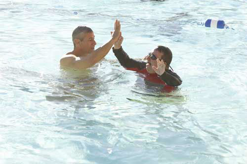 "<div class=""meta image-caption""><div class=""origin-logo origin-image ""><span></span></div><span class=""caption-text"">SPLASH - ""Splash"" marks the first time 10 celebrities will train and compete in regulation platform and springboard diving at dizzying heights in front of a weekly poolside audience. Leading up to the competition, the world's most decorated and medaled diving legend, Greg Louganis, will give each celebrity weeks of training. Each dive will be critiqued by the judges, London Olympic U.S. Gold medalist David Boudia and Australian Olympic athlete and USA Dive Team director Steve Foley. ""Splash"" premieres TUESDAY, MARCH 19 (8:00-9:00 p.m., ET) on The ABC Television Network. (ABC/KELSEY MCNEAL) GREG LOUGANIS, CHUY BRAVO (Photo/Kelsey McNeal)</span></div>"