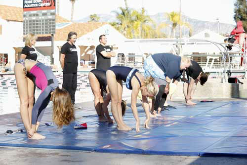 "<div class=""meta image-caption""><div class=""origin-logo origin-image ""><span></span></div><span class=""caption-text"">SPLASH - ""Splash"" marks the first time 10 celebrities will train and compete in regulation platform and springboard diving at dizzying heights in front of a weekly poolside audience. Leading up to the competition, the world's most decorated and medaled diving legend, Greg Louganis, will give each celebrity weeks of training. Each dive will be critiqued by the judges, London Olympic U.S. Gold medalist David Boudia and Australian Olympic athlete and USA Dive Team director Steve Foley. ""Splash"" premieres TUESDAY, MARCH 19 (8:00-9:00 p.m., ET) on The ABC Television Network. (ABC/KELSEY MCNEAL) KATHERINE WEBB, NICOLE EGGERT (OBSCURED), KENDRA WILKINSON, LOUIE ANDERSON, DRAKE BELL (Photo/Kelsey McNeal)</span></div>"