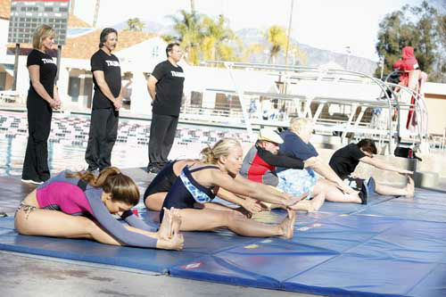 "<div class=""meta ""><span class=""caption-text "">SPLASH - ""Splash"" marks the first time 10 celebrities will train and compete in regulation platform and springboard diving at dizzying heights in front of a weekly poolside audience. Leading up to the competition, the world's most decorated and medaled diving legend, Greg Louganis, will give each celebrity weeks of training. Each dive will be critiqued by the judges, London Olympic U.S. Gold medalist David Boudia and Australian Olympic athlete and USA Dive Team director Steve Foley. ""Splash"" premieres TUESDAY, MARCH 19 (8:00-9:00 p.m., ET) on The ABC Television Network. (ABC/KELSEY MCNEAL) KATHERINE WEBB, NICOLE EGGERT (OBSCURED), KENDRA WILKINSON, CHUY BRAVO, LOUIE ANDERSON, DRAKE BELL (ABC Photo/ Kelsey McNeal)</span></div>"